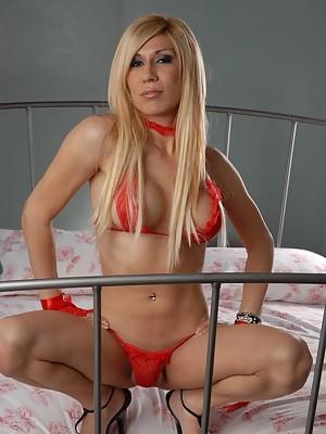 Blonde transsexual hottie posing in bed